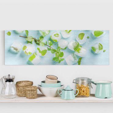 Leinwandbild - Eiswürfel mit Minzblättern - Panorama Quer