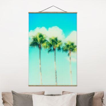 Stoffbild mit Posterleisten - Palmen vor Himmel Blau - Hochformat 3:2