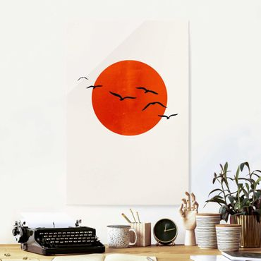 Glasbild - Vogelschwarm vor roter Sonne I - Hochformat 3:2