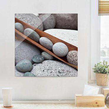 Glasbild - Stillleben mit grauen Steinen - Quadrat 1:1