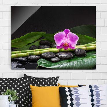Glasbild - Grüner Bambus mit Orchideenblüte - Querformat 3:4