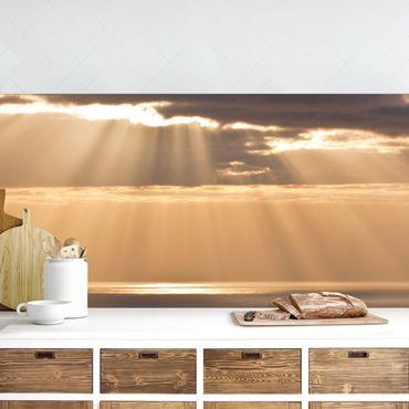 Küchenrückwand - Sonnenstrahlen über dem Meer