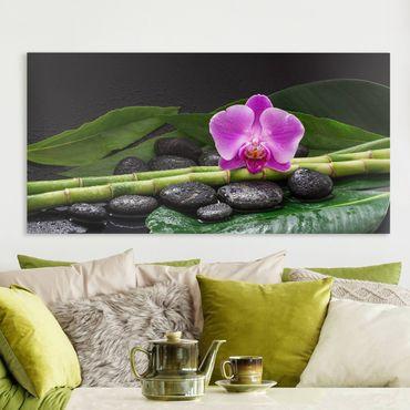 Leinwandbild - Grüner Bambus mit Orchideenblüte - Querformat 1:2