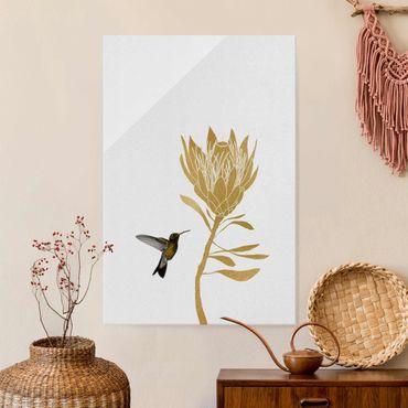 Glasbild - Kolibri und tropische goldene Blüte - Hochformat
