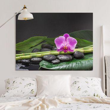Leinwandbild - Grüner Bambus mit Orchideenblüte - Querformat 3:4