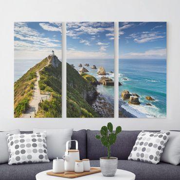 Leinwandbild 3-teilig - Nugget Point Leuchtturm und Meer Neuseeland - Hoch 1:2
