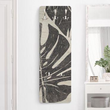 Garderobe - Palmenblätter vor Hellgrau