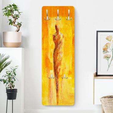 Garderobe - Figur in Gelb