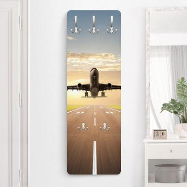 Garderobe - Startendes Flugzeug