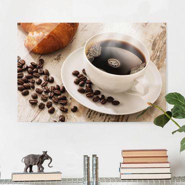Glasbild - Dampfende Kaffeetasse mit Kaffeebohnen - Quer 3:2