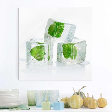 Glasbild - Drei Eiswürfel mit Melisse - Quadrat 1:1