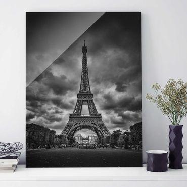 Glasbild - Eiffelturm vor Wolken schwarz-weiß - Hochformat 4:3