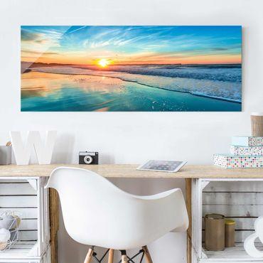 Glasbild - Romantischer Sonnenuntergang am Meer - Panorama Quer