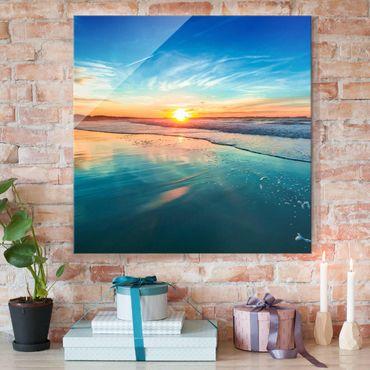 Glasbild - Romantischer Sonnenuntergang am Meer - Quadrat 1:1