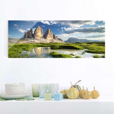 Glasbild - Südtiroler Zinnen und Wasserspiegelung - Panorama Quer