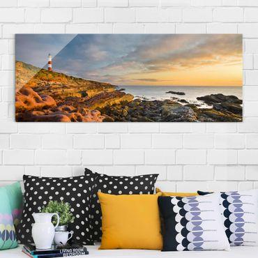 Glasbild - Tarbat Ness Leuchtturm und Sonnenuntergang am Meer - Panorama Quer