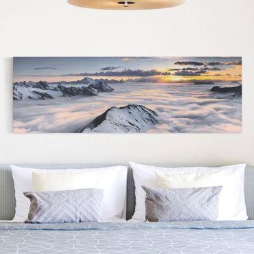 Leinwandbild - Blick über Wolken und Berge - Panorama Quer