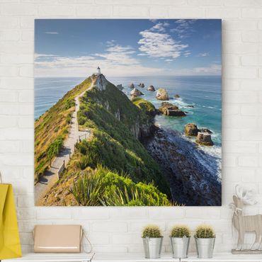 Leinwandbild - Nugget Point Leuchtturm und Meer Neuseeland - Quadrat 1:1