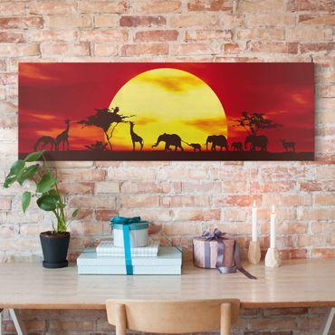 Afrika Leinwandbild Sunset Caravan - Elefanten, Giraffen, Rot, Gelb, Panorama Quer