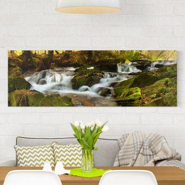 Leinwandbild - Wasserfall herbstlicher Wald - Panorama Quer