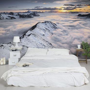 Fototapete Blick über Wolken und Berge