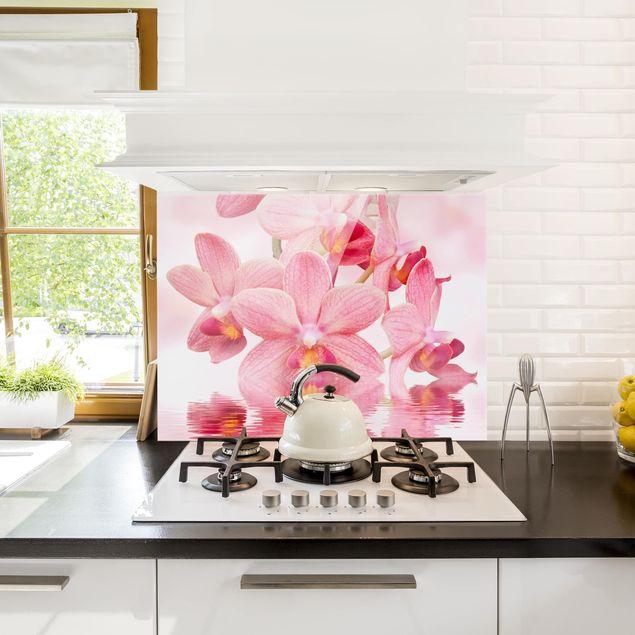 Glas Spritzschutz - Rosa Orchideen auf Wasser - Querformat - 4:3