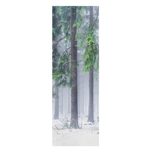 Leinwandbild - Nadelbäume im Winter - Panorama Hochformat 1:3