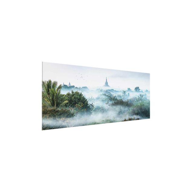 Glasbild - Morgennebel über dem Dschungel von Bagan - Panorama