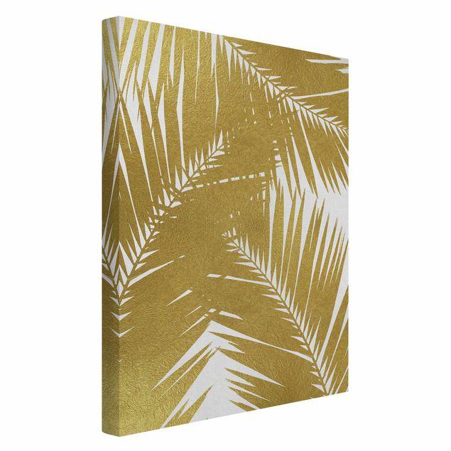 Leinwandbild - Blick durch goldene Palmenblätter - Hochformat 2:3