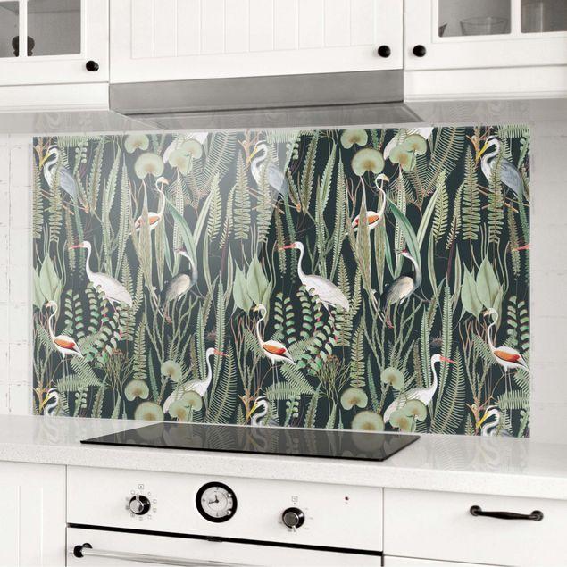 Spritzschutz Glas - Flamingos und Störche mit Pflanzen auf Grün - Querformat 2:1