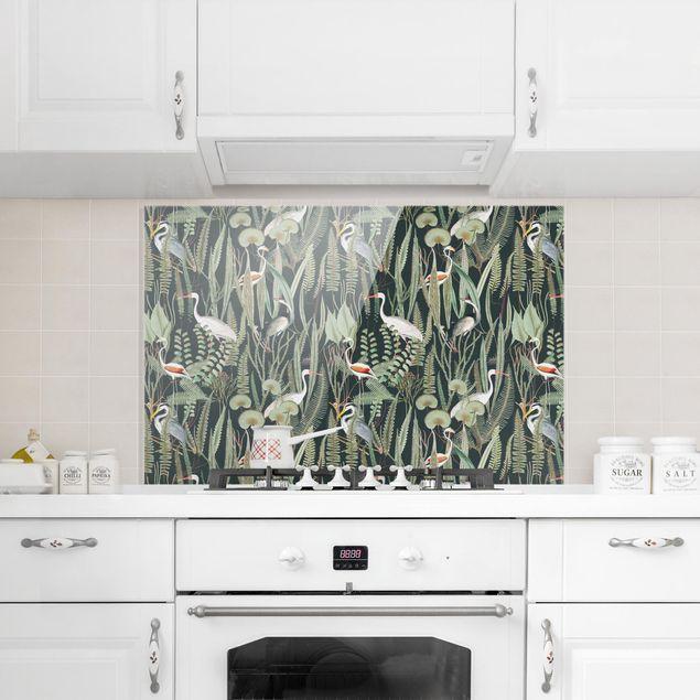 Spritzschutz Glas - Flamingos und Störche mit Pflanzen auf Grün - Querformat 3:2