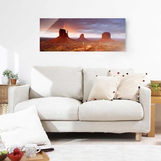 Glasbild - Monument Valley bei Sonnenuntergang - Panorama Quer