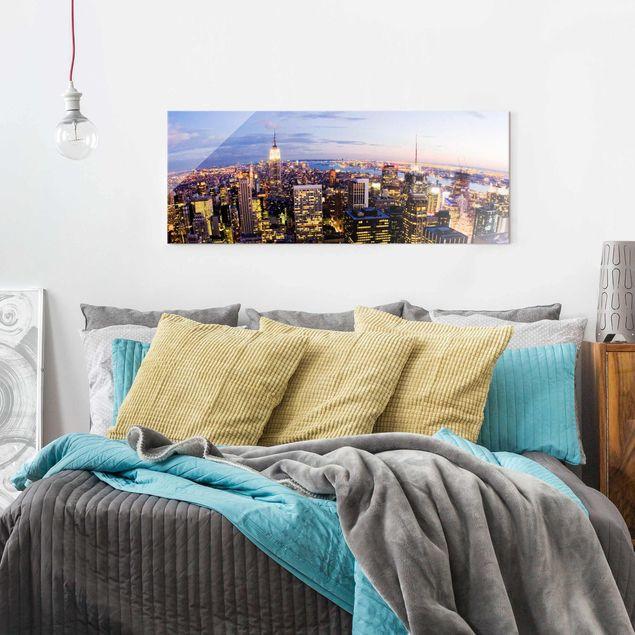 Glasbild - New York Skyline bei Nacht - Panorama Quer