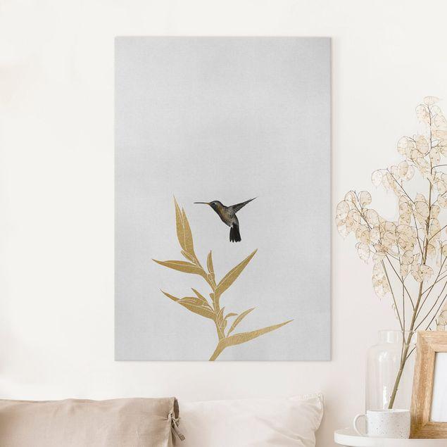 Leinwandbild - Kolibri und tropische goldene Blüte II - Hochformat 2:3