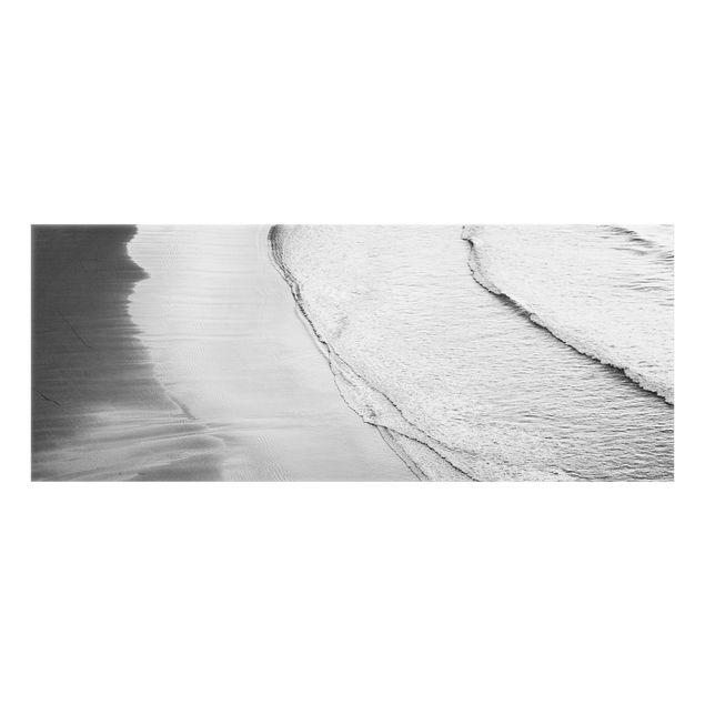 Spritzschutz Glas - Leichter Wellengang am Strand Schwarz Weiß - Panorama 5:2