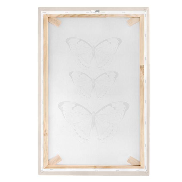 Leinwandbild - Schmetterling auf Beige - Hochformat 2:3