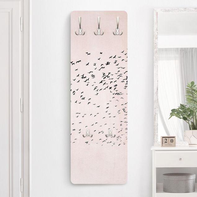 Garderobe - Vogelschwarm im Sonnenuntergang