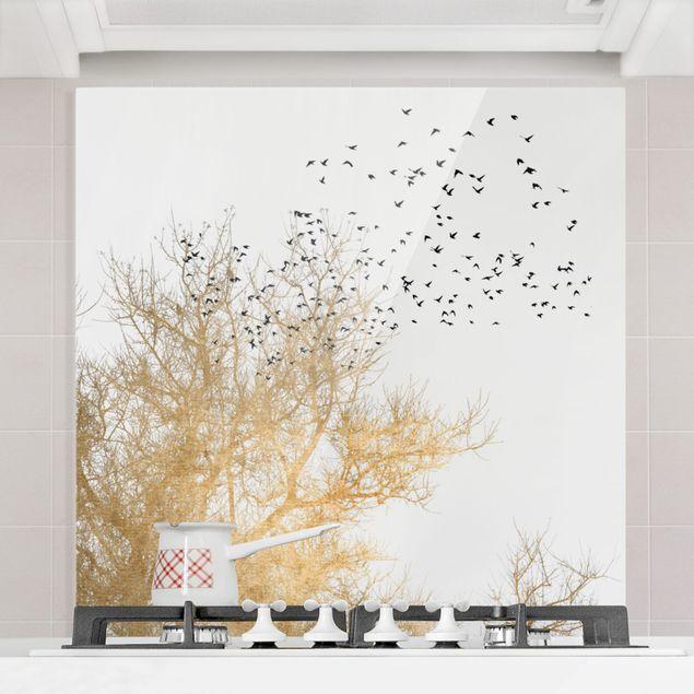 Spritzschutz Glas - Vogelschwarm vor goldenem Baum - Quadrat 1:1