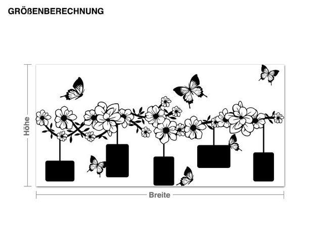 Wandtattoo Blumenranke mit Schmetterlingen
